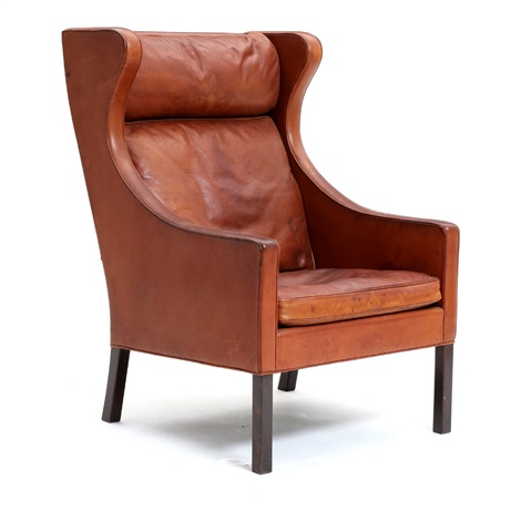A High Backed Wing Chair With Mahogany Legs Upholstered With Patinated Brown Leather By Borge Mogensen On Artnet