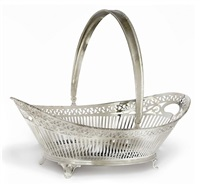 swing-handled cake basket by d.j. aubert