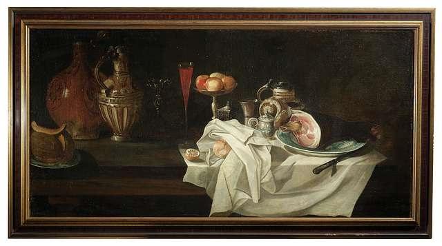 großes frühstücksstilleben mit einem schinken auf einem teller, krügen, obstschale, pokal mit rotwein und aufgeschnittener melone by alexander adriaenssen