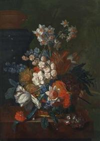 stillleben mit tulpen, narzissen und weiteren blüten in einem korb auf einer marmorbrüstung by pieter faes