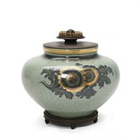 a porcelain lid jar decorated with greyish green crackle glaze by knud andersen