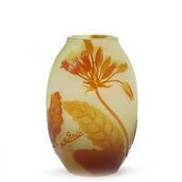 oval shaped vase overlaid with yellow and reddish with motifs of flowers and leaves by émile gallé
