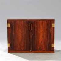 wall mounted brazilian rosewood cabinet with brass fittings by svend langkilde