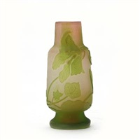 small vase overlaid with motifs in the shape of leaves and flowers by émile gallé