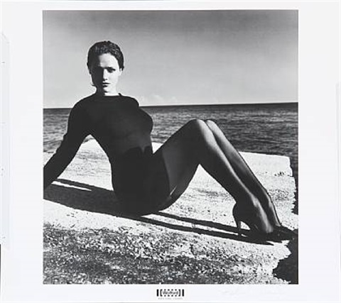 seated model from the wolford portfolio by helmut newton