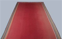rectangular woven red carpet by puk lippmann