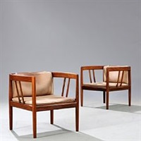 a pair of brazilian rosewood armchairs with vertical bars in sides and back by illum wikkelsø