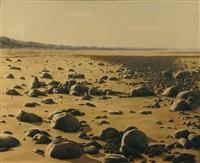 gros galets venus sur une plage de sable fin après une tempête by jean chouet