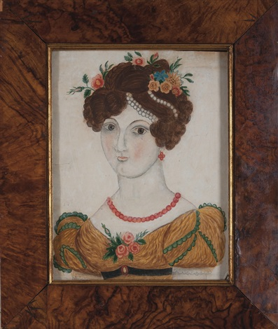 young lady in a gold colored gown her hair dressed with flowers and pearls by emily eastman