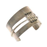 cuff bracelet with corset strapping by ed wiener