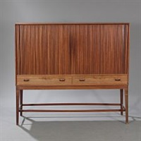 rosewood cabinet mounted on tall, tapering legs by svenn eske kristensen