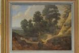 wooded landscape with figures on a path by lucas achtschellinck