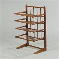 a stained beech music note stand with four slat shelves by josef frank
