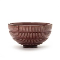 bowl modelled with vertical fluted pattern on the outside by arno malinowski