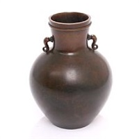 a double-handled vase by just andersen