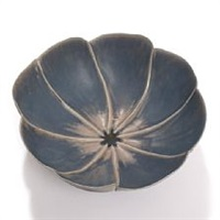 a thin stoneware flower shaped bowl by tove anderberg