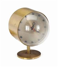 a brass table clock by george nelson
