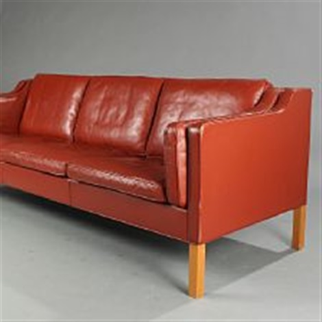A Free Standing Three Seater Sofa With Cherry Legs By Borge
