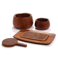 two bowls, round butter board with knife and a rectangular tray (set of 4) by jens quistgaard