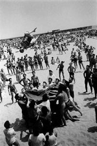 coney island beach (girl somersaulting) by steve schapiro