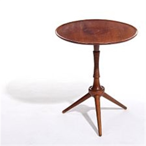 A Circular Side Table With Slightly Raised Edge By Frits Henningsen