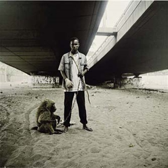 animal handler with ajusco lagos nigeria by pieter hugo