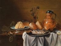 stillleben mit hering auf einem zum teil gedeckten tisch by cornelisz mahu