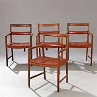 a set of four patinated oak armchairs by helge vestergaard jensen