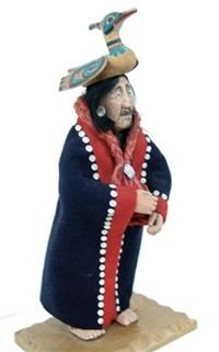 chief doll with bird headdress, button blanket, tradecloth kilt and woven jute wrap by shona ha