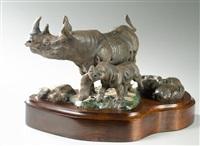 rhinos in a rocky setting by dan huber