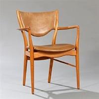 a teak armchair by finn juhl