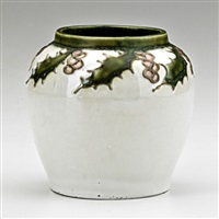 squat vessel decorated in squeezebag with holly leaves and berries by frederick hurten rhead