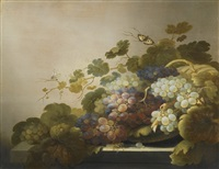 still life with grapes and vines arranged in a basket on a stone ledge, with butterflies, a grasshopper and a spider by roelof koets the elder