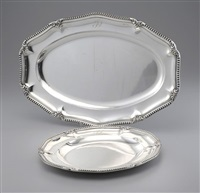 plat oval et plat rond (set of 2) by jean emile puiforcat