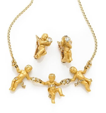 A Collection Of Cherub Jewelry Comprising A Necklace And