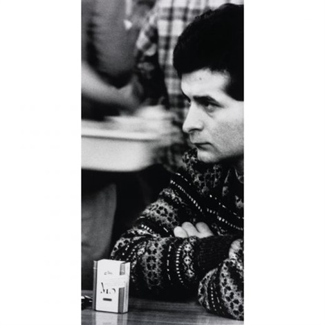 situation man with cigarette pack on table by sam samore