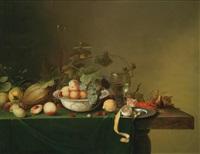 ein früchtestillleben mit einer porzellanschale, einem römer und einem gekochten hummer by michiel simons
