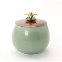 white stoneware mass lid jar decorated with celadon glaze by knud andersen