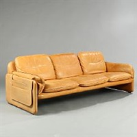 a free-standing three-seater sofa by de sede