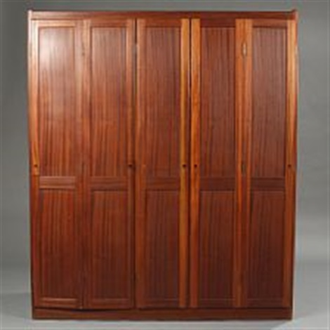 a mahogany wardrobe with two folding doors and minor central door by børge mogensen & A mahogany wardrobe with two folding doors and minor central door by ...