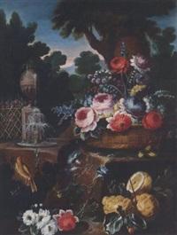 natura morta di fiori in cesto, limoni, in giardino con fontana by aniello ascione