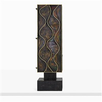 rare wavy front cabinet by paul evans