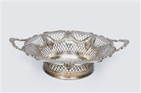 a handled bowl with decor of garlands by atkin brothers