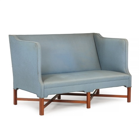 freestanding two seater sofa with profiled cross legged frame of