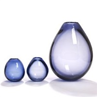 three drop-shaped blue glass vases by per lutken