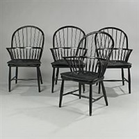 a set of four armchairs by frits henningsen