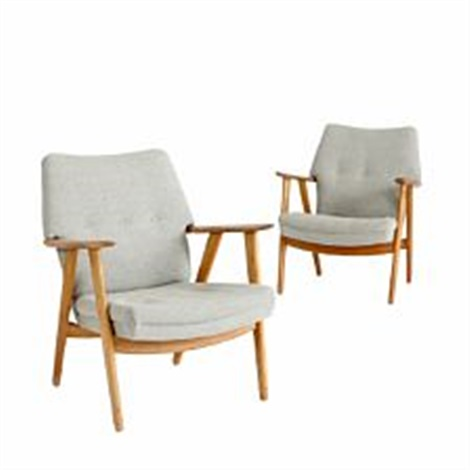 A pair of easy chairs with oak frame by Kurt Olsen on artnet
