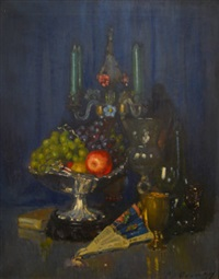 still life of grapes and an apple in a tazza, a chalice and a goblet with a candelabra by patrick william adam