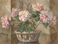 roses in a wicker basket by josette anis vaillancourt