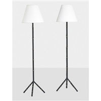 assembled pair of floor lamps by jacques adnet